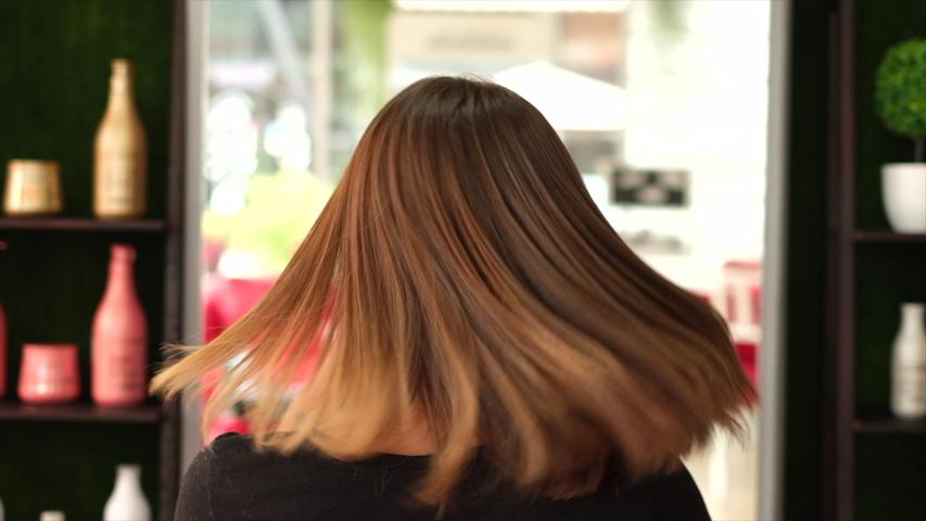 A client after keratin bonding hair straightening in beauty salon     | Shutterstock HD Video #1056197327