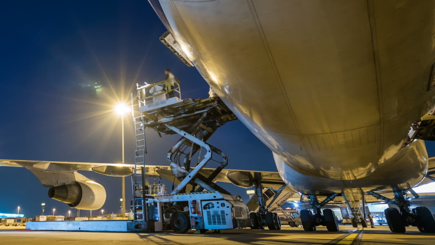 Time lapse cargo aircraft loading - Panning  Royalty-Free Stock Footage #1056198293