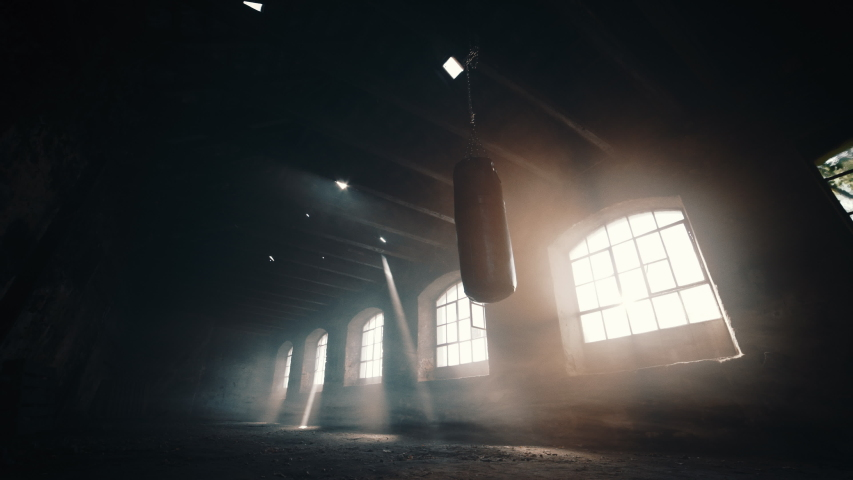 Punching bag in a deserted room up-angle	  Royalty-Free Stock Footage #1056219647