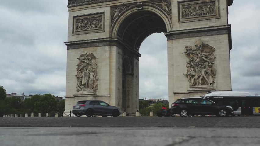 Aerial video of the Arc de Triomphe in Paris, Arc de Triomphe in Paris, Drone view in France, panoramic view of Paris, Arc de Triomphe, Famous places in France, famous places in Paris, France   Shutterstock HD Video #1056224372