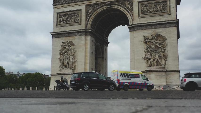 Aerial video of the Arc de Triomphe in Paris, Arc de Triomphe in Paris, Drone view in France, panoramic view of Paris, Arc de Triomphe, Famous places in France, famous places in Paris, France   Shutterstock HD Video #1056224378