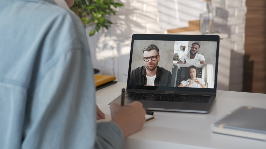 Discussing project online. Group video call. Remote communication of happy multiracial young people. Working from modern home office during pandemic. Business chat conference talking with teacher 4K | Shutterstock HD Video #1056237074