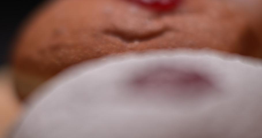 Sprinkling sugar powder on hanukkah jelly doughnut, slow motion, BMPCC 4K