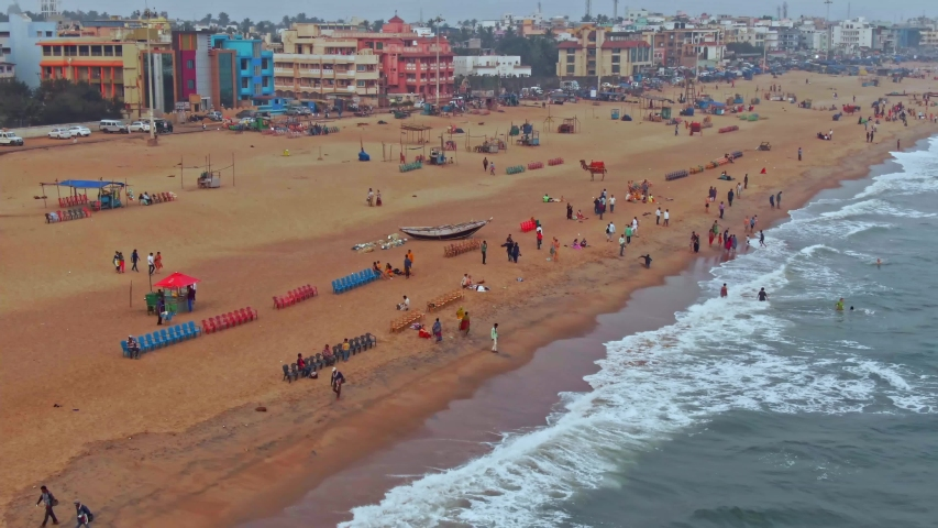 Aerial view of a crowded beach in India, Puri, Orissa. 4k