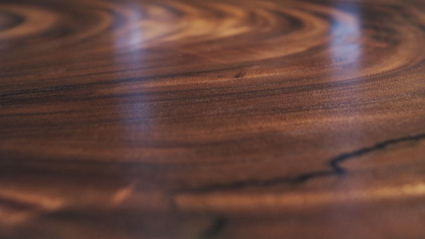 Close-up of lacquered wood texture. Copy space. Background Royalty-Free Stock Footage #1056272813