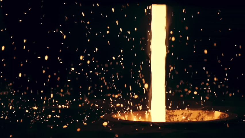 Hypnotizing Beautiful Yellow Stream of Hot Liquid Molten Steel and Bright Sparks Against the Black Background. Metal is Pouring into Huge Vessel, Modern Iron Manufacture Industry, Slow Motion