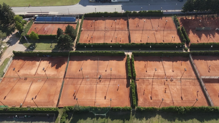 Aerial view of tennis court, tennis training facility camp residencial area of rich capital in europe Royalty-Free Stock Footage #1056277721