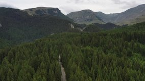 Drone 4k clip with car traveling on the Trans Bucegi mountain road high up in the Carpathian Mountains.