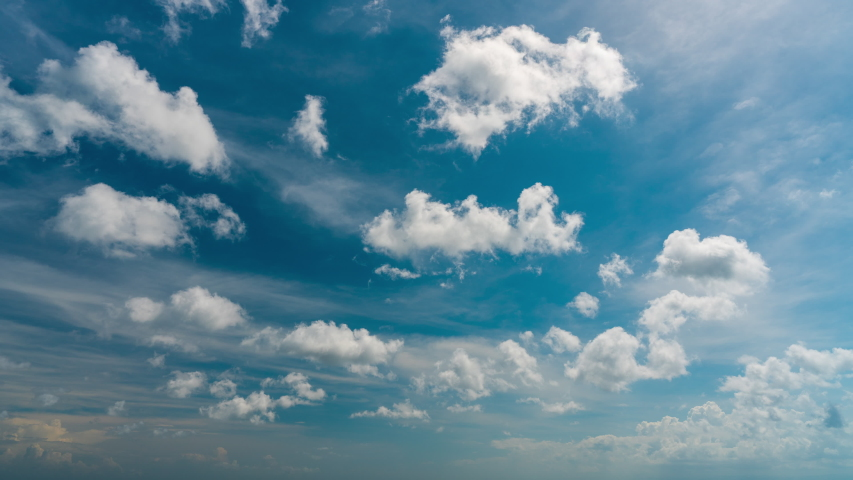 beautiful blue sky with clouds background.Sky clouds.Sky with clouds weather nature cloud blue.Blue sky with clouds and sun. Royalty-Free Stock Footage #1056283103
