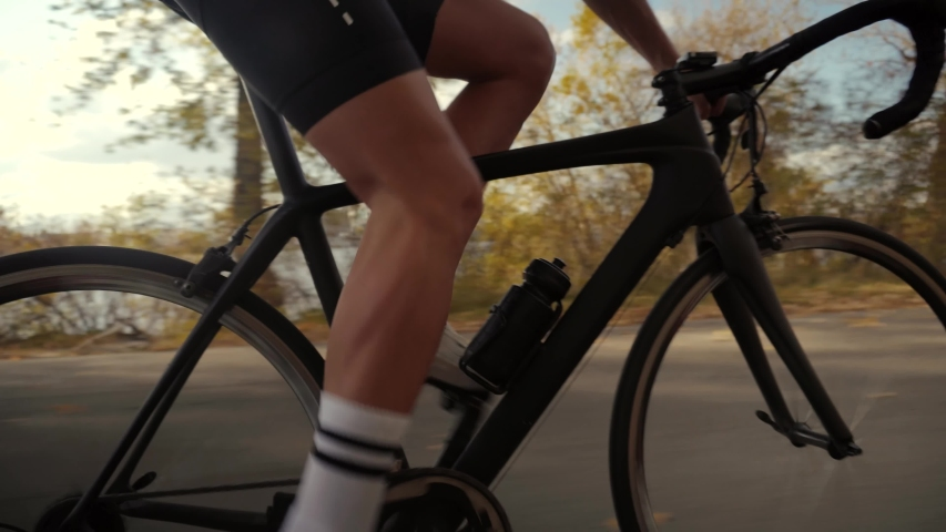 Hard Workout.Triathlete Cyclist Training On Bicycle.Cyclist Sport Fitness Riding Road Bike Ready  Triathlon.Fit Athlete Workout Training Cycling For Triathlon Competition.Sport Concept Transportation. Royalty-Free Stock Footage #1056292727