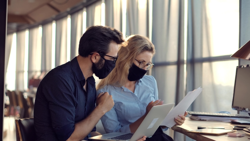 Two Colleagues Talking In Face Mask Office On Covid19 Coronavirus Pandemic Quarantine Lockdown.Coworkers Together In Lockdown Avoid Self Distance.Employee Cooperating In Working Together On Workplace Royalty-Free Stock Footage #1056292760