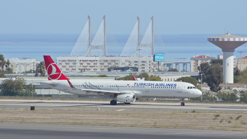 LISBON, PORTUGAL - 2020: Turkish Airlines Airbus A321 Jet Airliner Taxiing at Lisbon Portugal Humberto Delgado Portela International Airport Ground on a Blue Sky Sunny Day