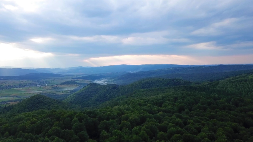 Beautiful drone panoramic view of green forest in the mountains. Summer day. 4k nature video.  | Shutterstock HD Video #1056293408