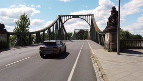 Riding a bicycle across Glienicke bridge between Berlin and Potsdam, 4k POV video footage