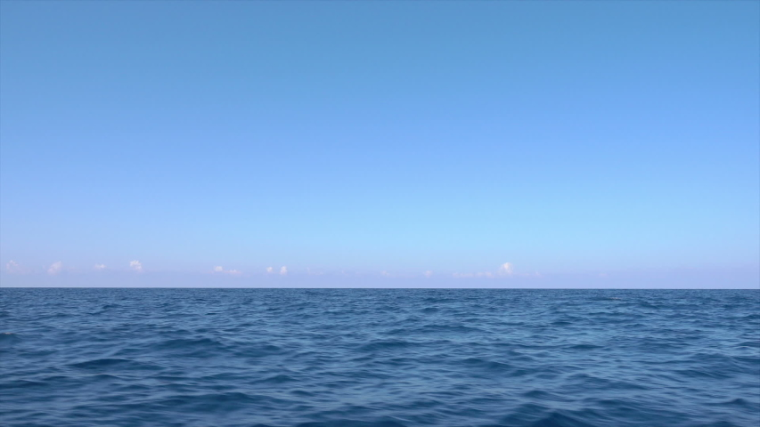 Blue sky and tranquil water at sea with horizon, Mediterranean  | Shutterstock HD Video #1056326543
