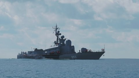 SOCHI, RUSSIA - March 15, 2020. Coast guard ship. Military nautical vessel with various navigation and location equipment on board is in full speed to the port of Sochi. Russia.