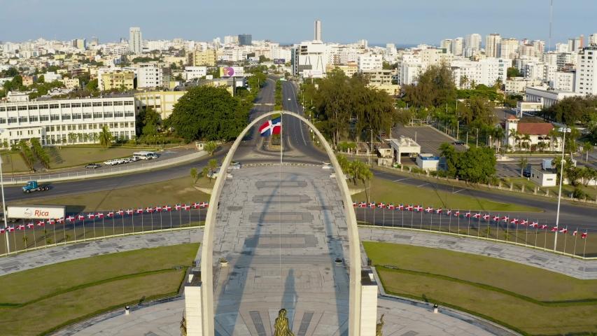 Empty and desolate streets by Flag Square (Plaza de la Bandera) patriotic monument in city of Santo Domingo, Dominican Republic, covid-19 pandemic, circle aerial | Shutterstock HD Video #1056332510