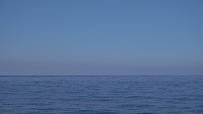 Blue sky and tranquil water at sea with horizon, Mediterranean  | Shutterstock HD Video #1056341465