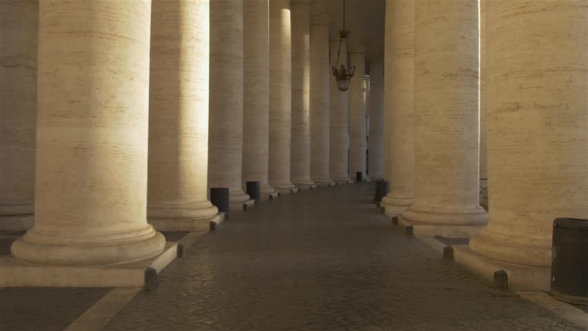 POV (first person point of view) flying sequence in the Vatican City (Rome, Italy) through the colonnades / pillars of St. Peter's Square.   Relevant to coronavirus, covid-19, sars-cov-2 corona virus.
