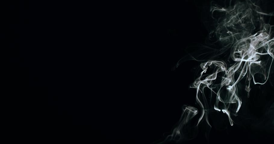 Vapor smoke wisps slowly rising effect overlay dark background video footage | Shutterstock HD Video #1056351494
