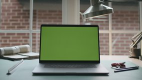 Architecture desk work space. Green screen laptop computer sitting on a home work desk. Footage shot with RED, available in 4K and HD. Download the preview for free.