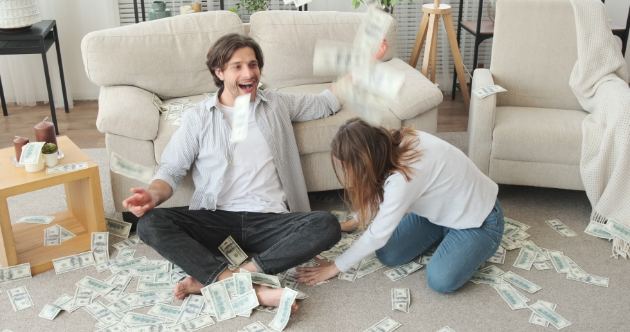 Crazy couple throwing cash dollars in air