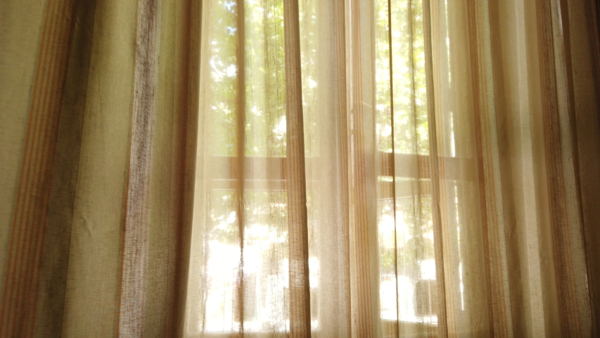 Window curtains swaying in the wind, light coming through Royalty-Free Stock Footage #1056384551