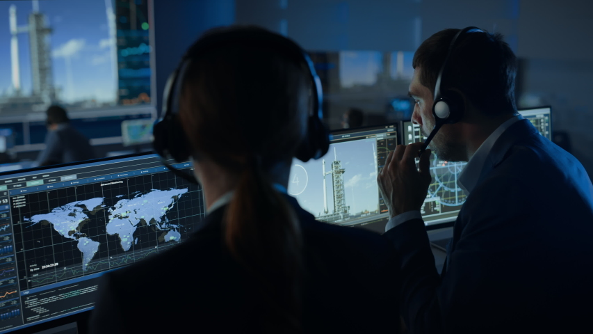 Flight Director Counts Down the Seconds Before Space Rocket Launch. Team in Mission Control Witness Successful Lift Off. Flight Control Employees Sit in Front of Computers and Monitor the Mission. | Shutterstock HD Video #1056388151
