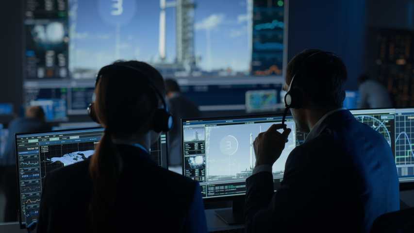 Flight Director Counts Down the Seconds Before Space Rocket Launch. Team in Mission Control Witness Successful Lift Off. Flight Control Employees Sit in Front of Computers and Monitor the Mission. | Shutterstock HD Video #1056388166