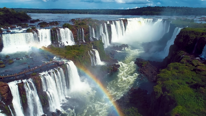 Summer travel. Aerial landscape of giant waterfalls with beauty rainbow. Panorama view of famous Igacu Falls. Vacation travel. Tropical travel. Travel destination. Leisure scene. Parana, Brazil. | Shutterstock HD Video #1056389213