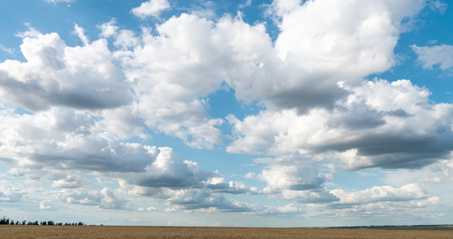Beautiful clouds in the field, time lapse, summer beautiful landscape, video loop Royalty-Free Stock Footage #1056390317