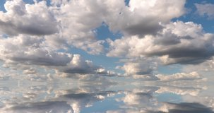 futuristic background consisting of Time lapse clip of white fluffy clouds over blue sky and their reflection, video loop