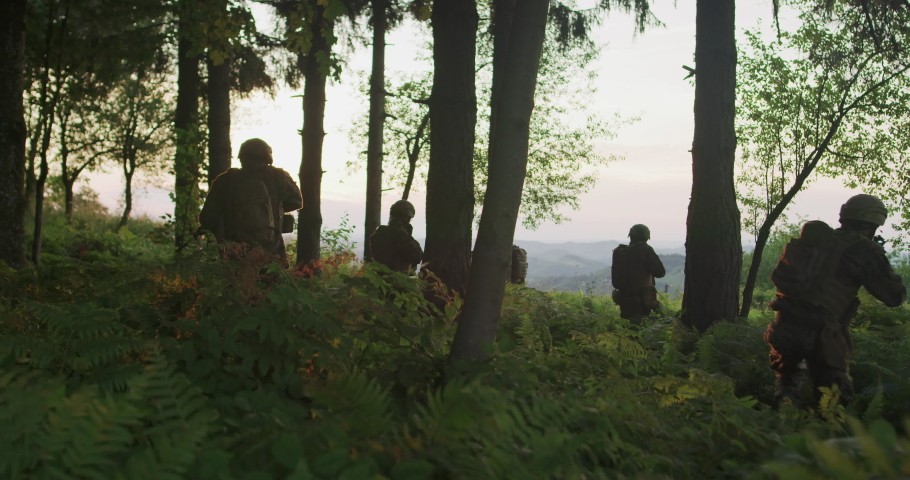 Group of soldiers protecting front line and conducting complex military action