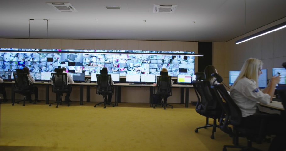 Security control room operator at work, Security System Operator Looking At Cctv Footage Royalty-Free Stock Footage #1056395540