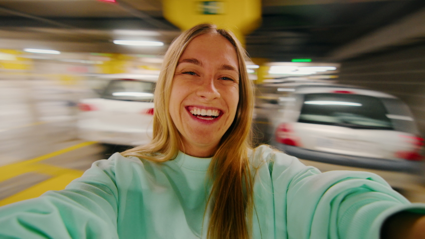 User generated content, couple pov girlfriend spinning with boyfriend in shopping mall parking lot. portrait of happy woman on wide angle action camera laughing and smiling, have great time in love Royalty-Free Stock Footage #1056401636