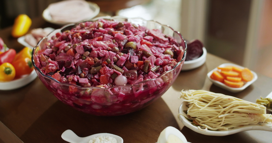 Fiambre topping ingredients before decoration: a traditional Guatemalan cold cut dish that is prepared in advance to eat on the Day of the Dead. (cold meats, beet, vegetables and vinegar broth) Royalty-Free Stock Footage #1056406547