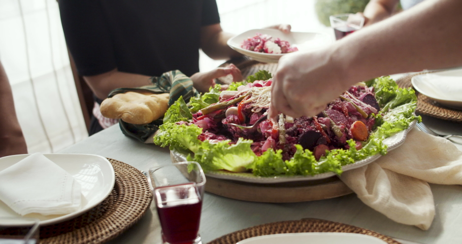 Fiambre: a traditional Guatemalan cold cut dish served in an elegant table on Day of the Death local Celebration. Hands of family members show the traditional get together on November 1 every year.  Royalty-Free Stock Footage #1056406859