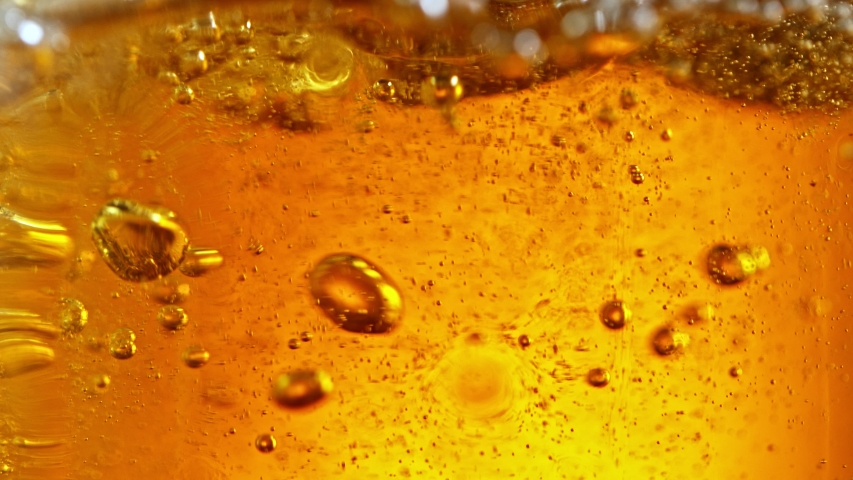 Super Slow Motion Detail Shot of Beer Bubbles in Glass | Shutterstock HD Video #1056417488