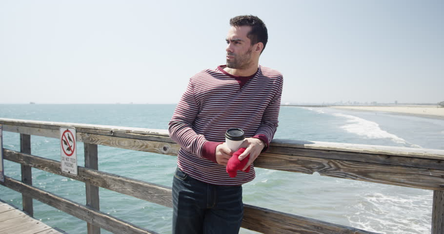 Young caucasian adult man thinking about date on a pier | Shutterstock HD Video #10564268