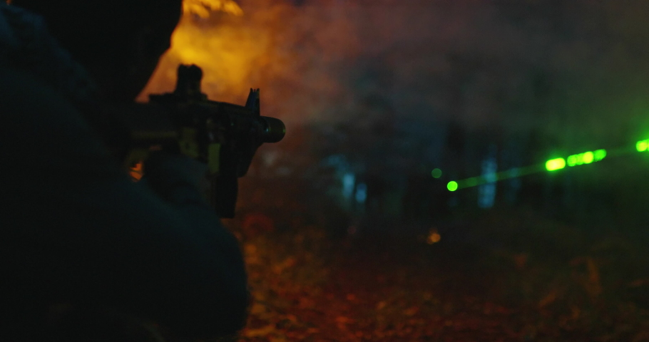 Anti terrorism and military action in forest at night   Shutterstock HD Video #1056447845