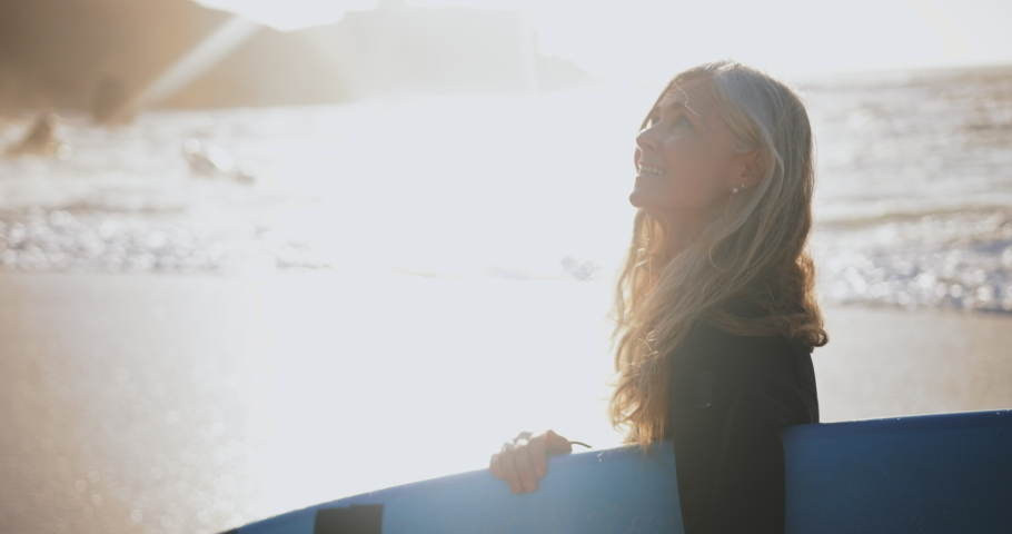 Close up senior beautiful woman holding surfboard at the beach Royalty-Free Stock Footage #1056480161