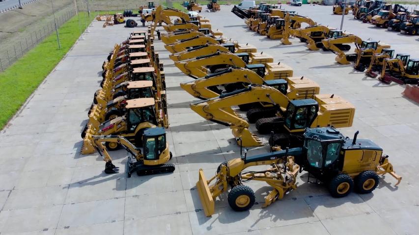 Heavy construction equipment store. excavator, bulldozer, grader, front loader. Aerial view