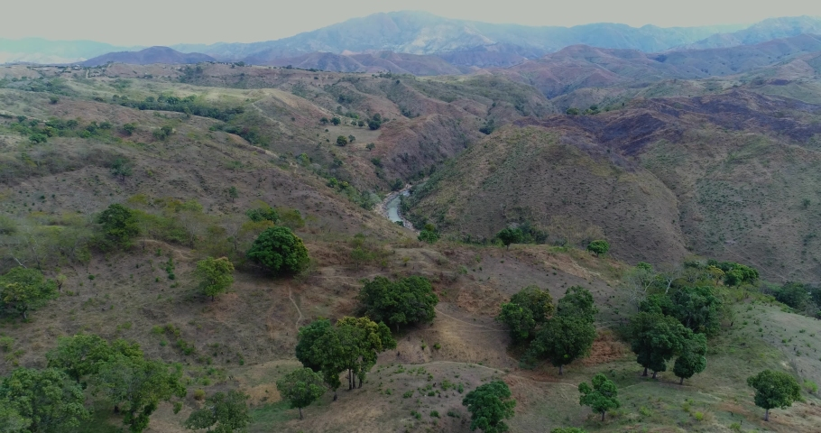 Aerial drone shot of the mountains that divide the dominican republic with haiti