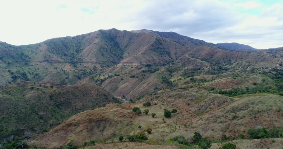 The big mountains and dry land terrain is the panorama of the Dominican Republic border with Haiti