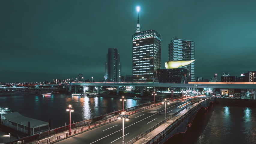 8K timelapse of Azuma bridge and Tokyo Skytree with Asahi beer hall in Asakusa district at night, Tokyo, Japan | Shutterstock HD Video #1056504674