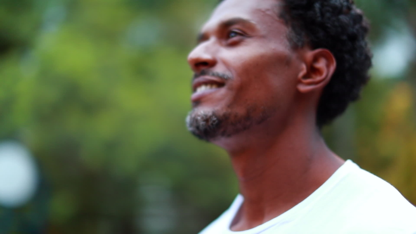 Faith African man looking to the sky, close-up black person face feeling hopeful Royalty-Free Stock Footage #1056518531