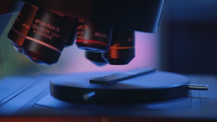 Lext Headquaters: Shinjuku, Tokyo, Japan. Close up image of microscope in laboratory. Scientist using hi-tech microscope examining sample in industrial lab Royalty-Free Stock Footage #1056569222