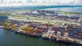 aerial view hyper lapse 4k video of container cargo ship in export and import business and logistics international goods in  Chonburi, Thailand. top view. hyperlapse.