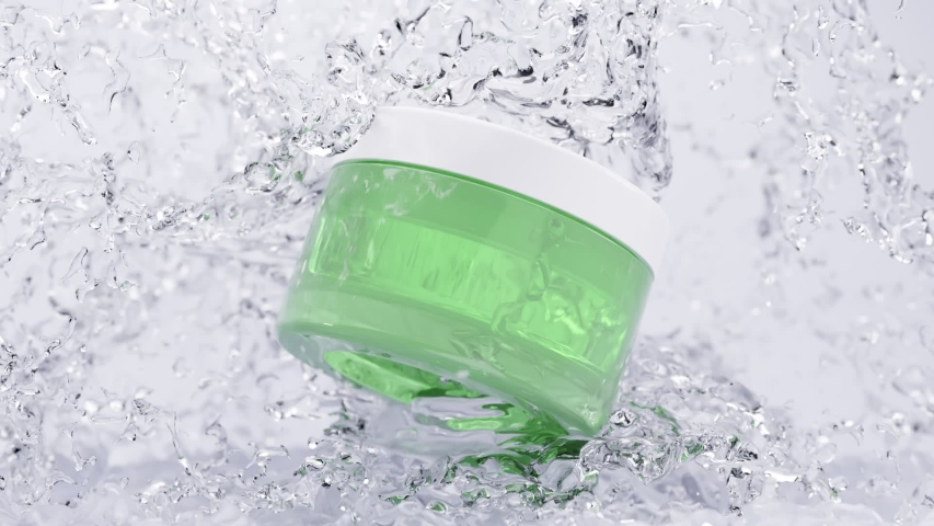 Cosmetic plastic green jar with transparent moisturizing cream and white lid in frozen water. Glass packaging in drops of water, jet of ice, cool, snow. Realistic layout of packaging 3d animation. | Shutterstock HD Video #1056591467