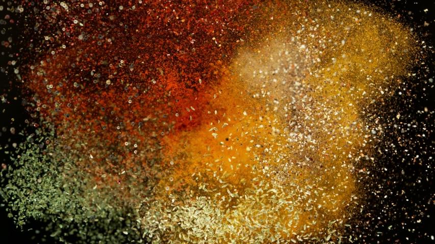 Super slow motion of flying spices mix on black background. Filmed on high speed cinema camera, 1000 fps